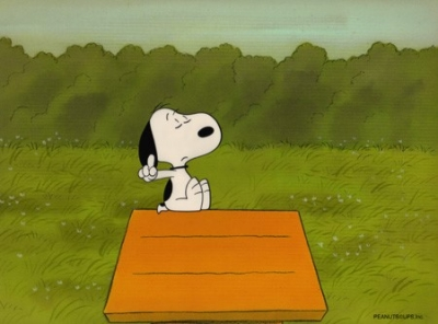 Snoopy sitting on his dog house
